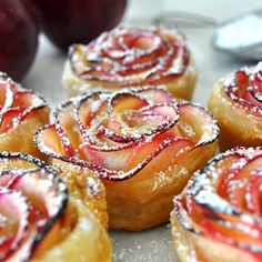 Apple Roses:       1 frozen puff pastry sheet, thawed     2 red organic apples (I used red delicious)     half lemon, juice     1 tablespoon of flour, to sprinkle the counter     3 tablespoons of apricot preserve     cinnamon (optional)     powder sugar for decorating (optional)