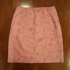 """Embroidered linen skirt Salmon colored linen pencil skirt, embroidered with flowers. Minimal bead embellishment--center of each flower and a few random stems are embellished with a single bead. Hidden side seam zipper with hook and eye closure. Fully lined. Waist 28"""" Length 19.5"""" Pristine condition! Ann Taylor Skirts"""