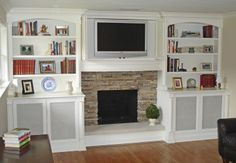white built ins tv and fireplace | mesh screen to hide electronics