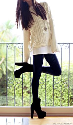 big, long white wool knit sweater, black leggings, and black heeled ankle boots.