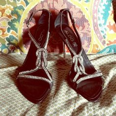 Black Rhinestone Sandal with Silver Heel BRAND NEW! Black Strappy High Heel with Rhinestones. Heels are Silvertone. Perfect for a Night Out, Special Occassion, Marine Corps Ball, etc. ALDO Brand Size 8 ALDO Shoes