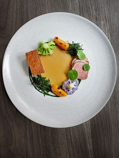 Pork, cauliflower, satsuma, and kale by chef Matt Lambert. © Signe Birck. - See more at: http://theartofplating.com/editorial/awakening-the-spirit-of-new-zealand-with-matt-lambert-at-the-musket-room/#sthash.OPBepvZv.dpuf