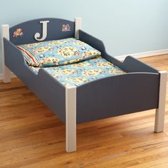custom toddler bed- love how it's boxed in so your toddler won't roll out