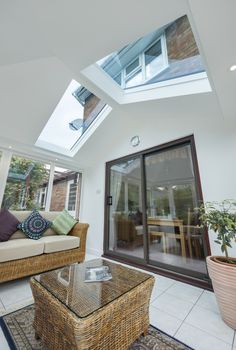 This stunning internal of an Ultraroof extension features full length glass panels that lets the natural light enter the room. The ultraroof can be a conservatory replacement project or available for new builds. Find your local Ultraroof installer today! Conservatory Interiors Small, Conservatory Ideas Sunroom, Conservatory Ideas Interior Decor, Tiled Conservatory Roof, Conservatory Lighting, Conservatory Extension, House Extension Design, Extension Ideas, Living Room Plan