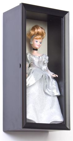 Doll Display Cases | Shadow Box Wall Case With Black Frame--I'm thinking about getting some of these for display of vintage Barbies. It looks like it will hold the pedestal stand. It will hold a wine bottle, so I think so. .  >^..^<