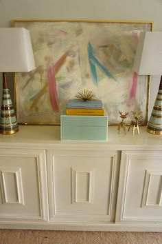 love the retro lamps and painted credenza