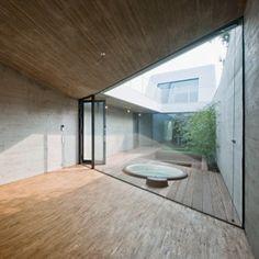 Caramel's narrow CJ5 House in Vienna encloses a sunken courtyard garden