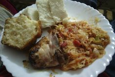Ugali, cabbages, roasted chicken,  side dish of a muffin