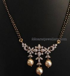 Simple yet elegant two layer black beads sets with elaborated diamond pendants in 18 carat yellow gold, gemstones studded on ...