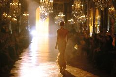 Charlize... absolutely in love with the setting, the dress and the Dior commercial.
