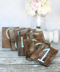 I could handle DIYing this. Set of 12 Rustic Nautical Beach Table Numbers Distressed Wedding Decor. $49.99, via Etsy.
