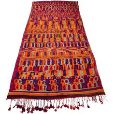 A very rare and absolutely stunning vintage rug made by the nomadic Ait Bou Ichaouen tribe circa 1980. This is a very special and unusual tribal art rug, tightly flat-woven with a freeform organic pattern in soft knotted wool. The overall effect is simply stunning. This really is a wonderful piece of art, a collector's dream. In excellent condition. #vintagerug #moroccanrug #aitbouichaouen #talsintrug #berberrug #colourfulrug