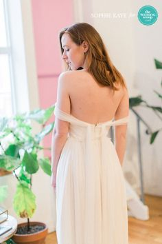 Gorgeous off the shoulder Sarah Seven wedding dress flowy back design // We're back with more refreshing New York Bridal Fashion Week finds from Milamira and Sarah Seven! Like your favs, Wedding Scoopers! // : Sophie Kaye Photography for The Wedding Scoop