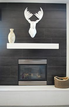 Cool tile surround on fireplace wall.