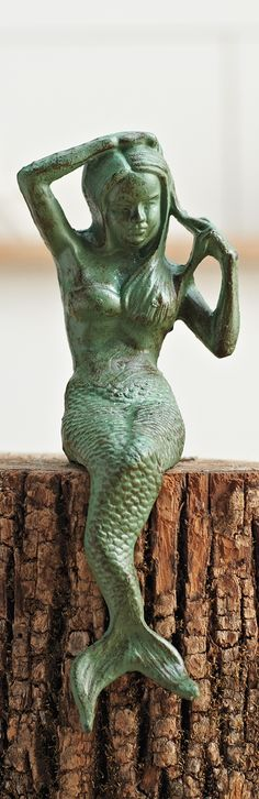 Prop our whimsical and mysterious mermaid sculpture on a shelf, a stack of books, or a console.