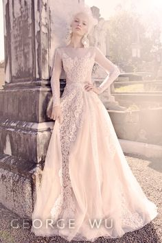 Vulcan Dress featuring French lace from the George Wu 'Sancta Sedes' 2015-2016 Bridal Collection. Panels on the skirt and straight trims used on the sleeves create a Roman pillar effect. Made in Australia. Repin for your own wedding inspiration. George Wu | Brisbane | Wedding | Custom | Bridal