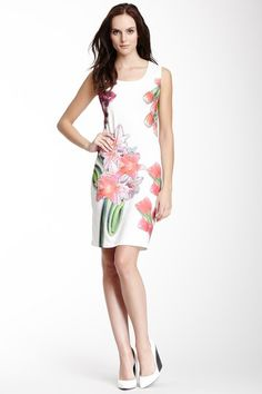 """Alexa Beaded Front Dress by Bacci $59.00 Kick off the warm weather in an ivory dress scattered with flowers - Scoop neck - Sleeveless - Beaded front detail - Allover graphic print - Approx. 36.5"""" length - Imported"""
