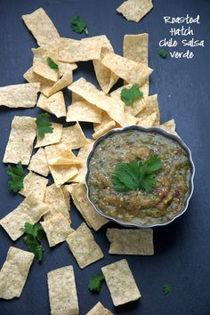 ROASTED HATCH CHILE SALSA VERDE A simple hatch chile salsa verde of roasted tomatillos, red onions and hatch chiles to make a sweet and smoky salsa that is perfect to any salty tortilla chip! Appetizer Dips, Appetizers For Party, Appetizer Recipes, Dip Recipes, Mexican Dishes, Mexican Food Recipes, Ethnic Recipes, Hatch Chile Salsa, Hatch Chili