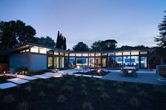 Klopf Architecture updated a classical 1950s original mid-century modern home designed by the late Frank Lloyd Wright apprentice Ellis Jacobs.