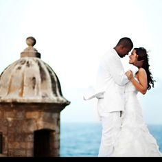Puerto Rico.  It's always been my dream to take pictures of us in our wedding attire at the Morro... someday.