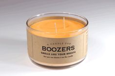 """Whiskey River Soap Company -- handmade soaps and candles (pictured: Candle for Boozers). Must read the names, descriptions, and scents, they're all hilarious! I love that """"Writer's Block"""" is cheap whiskey scented."""