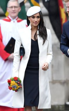 Meghan Markle attended her first official event alongside the Queen this afternoon when she joined Prince Harry and senior members of the Royal family for the annual Commonwealth Day Service at Westminster Abbey. Estilo Meghan Markle, Meghan Markle Hair, Meghan Markle Style, Amanda Wakeley, Vestidos Color Verde Militar, Manolo Blahnik, Hugo Boss, Crombie Coat, Layered Curls
