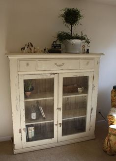 love this white vintage cupboard