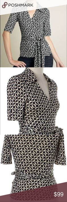 "Diane Von Furstenberg Jillianna Wrap Blouse Top 6 This is a Diane Von Furstenberg Jillianna Wrap Top. Size 6. Black and cream with O print. Made of 100% Silk. No flaws. Bust 37"" length 24"". Diane Von Furstenberg Tops Blouses"