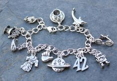 This handmade Hitchhikers Guide to the Galaxy themed charm bracelet is sure to please any fan of the famous book/radio show/movie. The charm bracelet
