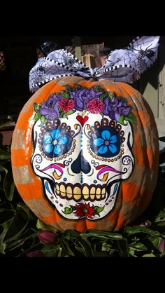 "I get a lot of requests for my ""Day of the Dead"" painted pumpkins! This one is painted with glow in the dark paint!"
