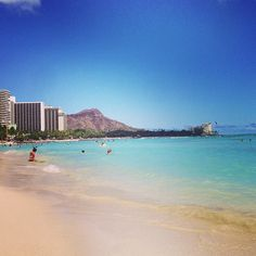 Waikīkī Beach in Honolulu, HI - where I first learned to surf.  While my best friend learned surfing makes her chuck.  HA!