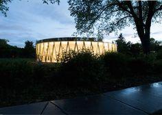 Mirrored Borden Park Pavilion glows like a lantern in Edmonton