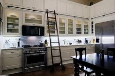 Love the library ladder to reach the high cabinets