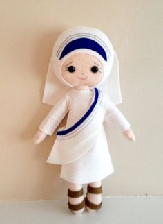 Hand-stitched and made of wool blend soft durable felt this sweet doll will be a great friend to your little one. Measures 13 inches tall. This