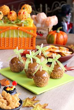 There's soooo much delightful Halloween yumminess contained in this one shot! There's Butterfinger Caramel Apples, Dot Candy Popcorn Balls, Candy Corn Cookies, and Cheddar Cheese Maple Leaf Crackers. Awesome! :) #food #crackers #popcorn_balls #candy #caramel #apples #Halloween #baking #party #snacks #appetizers #fall #kids #autumn #cookies #candy_corn #cheddar #Dots