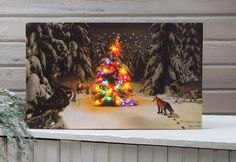 lighted Christmas tree in a winter forest with deer, fox and rabbit. A flickering LED lighted picture from the Radiance Lighted Canvas collection. Battery powered lights with timer feature light up the lights on the tree. Christmas Tree Canvas, Christmas Art, White Christmas, Christmas Decorations, Holiday Decor, Christmas Stuff, Vintage Christmas, Christmas Ornaments, Lighted Canvas Pictures