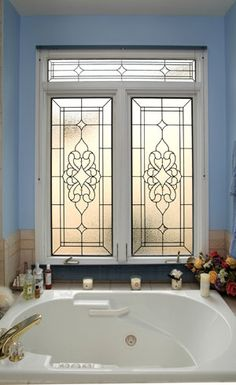Cute stained/leaded glass design in a modern window fixture http://www.scottishstainedglass.com/stained-glass-windows/stained-glass-bathrooms/#
