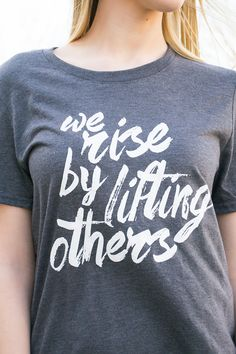"Inspirational graphic tees are in! Get our new ""We rise by lifting others"" today…"