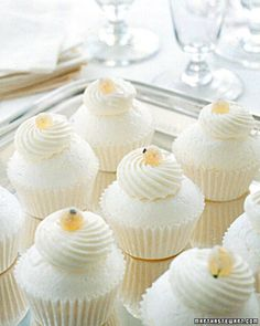 """Mini Pavlovas  Individual Pavlovas are both whimsical and elegant when served in miniature cupcake liners. The dessert was named for a Russian ballerina. The """"cake"""" portion of the cupcake is a puff of meringue, crispy on the outside and soft inside; each Pavlova is topped with a dollop of tangy yogurt cream and a sugared golden currant."""