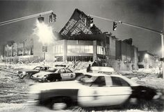 Hartford Police arriving at the scene of the Hartford Civic Center Coliseum roof collapse block traffic at the intersection of Ann and Church streets in the pre-dawn darkness on January 18, 1978.