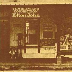 Tumbleweed Connection by Elton John. It's mostly him and his piano making some strong, American inspired music.