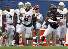 Antwan Goodley #5 of the Baylor Bears catches a 63 yard touchdown pass in the second quarter against Terrell Chestnut #16 of the West Virginia Mountaineers during the game on October 18, 2014 at Mountaineer Field in Morgantown, West Virginia.