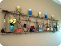 Huge old ladder, decorated in random nic nacs and a beautiful grape vine.  Hung on my living room wall. ~ Jess I love what u did with this! Such a great idea!
