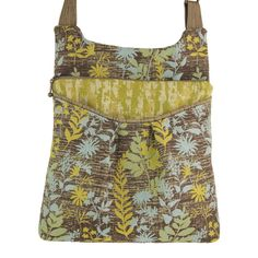 """Maruca Busy Body handbag in Fern Cool.  The sling with a boho vibe. Soft adjustable custom strap. Interior with small pocket. Open exterior pocket for quick access. 9"""" x 9.5"""" x 2"""" Strap drop length: 12"""" - 24"""" Web strap width: 1"""" Handmade in Boulder, CO. Shop The Handbag Store in store at 253 Main St, Hill City SD or online at www.shopthehandbagstore.com."""