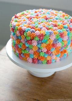 Bright birthday cake using #21 cake tip to decorate.