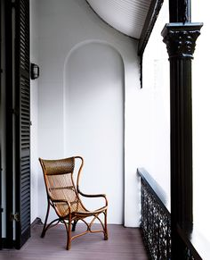 Colonial-style cane chair on the verandah.