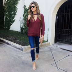 Brighton the day wearing wine long sleeve top, distressed jeans, nude accessories