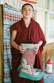Tibetan monk and rare high lama boots - good for how to wrap at shoulders
