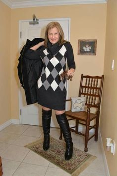 Amateur blonde at home modeling a gray argyle sweater dress and black OTK boots