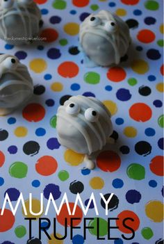 Mummy Truffles. Could do these w/ the Pumpkin Cheesecake Truffles recipe...